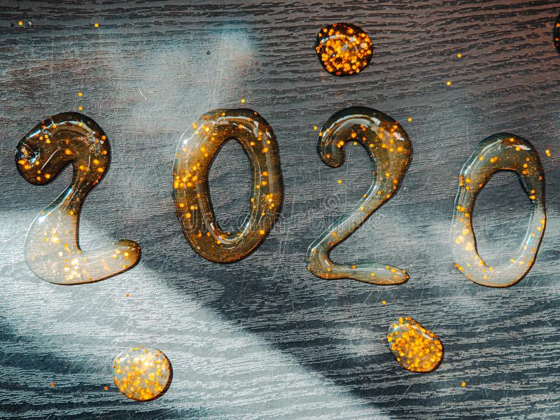 Wonderful Greeting card Happy New Year 2020. Creative Square holiday web banner or billboard with gold sequins 2020 written. Happy New Year 2020. Number 2020 royalty free stock photography