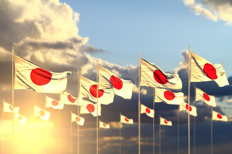 Pretty many Japan flags on sunset placed in row with selective focus and place for text - any feast flag 3d illustration. Wonderful holiday flag 3d illustration royalty free illustration