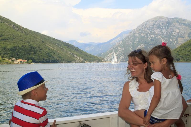 Wonderful journey with children. happy mother with her son and d. Aughter in her arms cross the magnificent Bay of Kotor on the ferryboat, sea, adriatic stock images