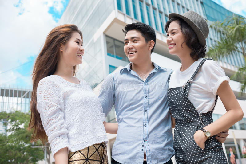 Wonderful life. Laughing youngsters standing and bonding outside stock image