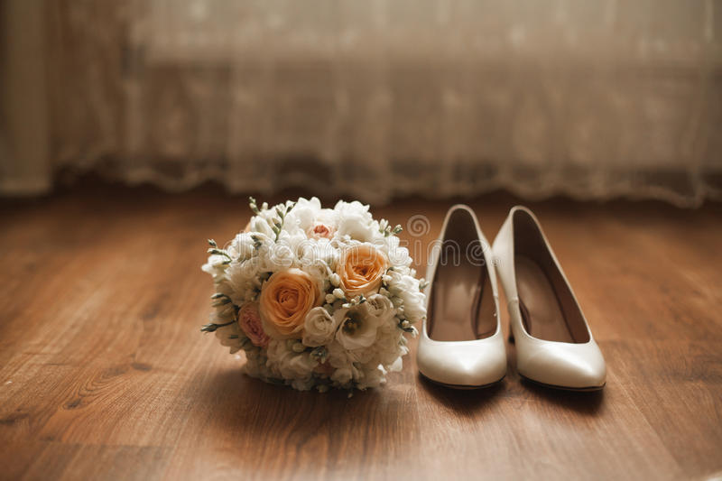 Wonderful luxury wedding bouquet with shoes of different flowers stock photo