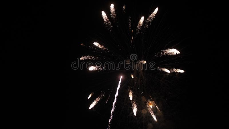 Wonderful magic fireworks explosion in the night sky royalty free stock photo