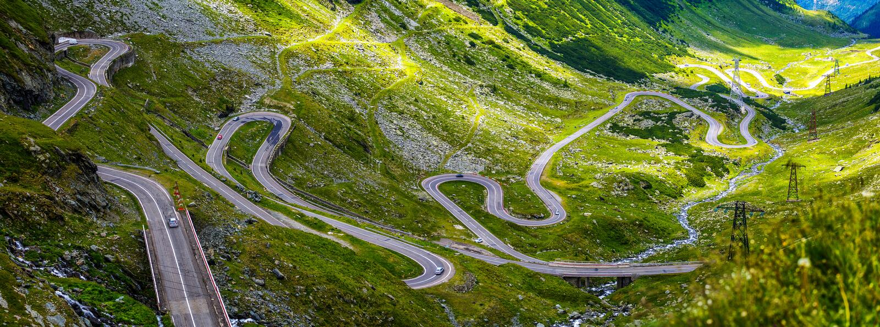 Wonderful sunny scenery. mountain road with perfect sky. Romania. Carpathians, Ridge Fagarash. Transfagarasan road. royalty free stock photos