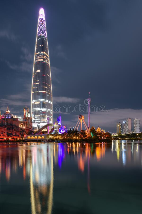 Wonderful night view of skyscraper reflected in lake, Seoul. Wonderful night view of skyscraper reflected in lake at downtown of Seoul in South Korea. Beautiful royalty free stock images