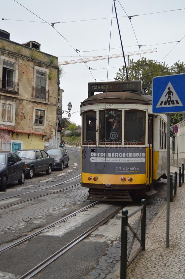 Wonderful Old Yellow Tram With A Photographer Taking Pictures Of The Monuments On Their Step Circulating Down The Streets In. Lisbon. Nature, Architecture royalty free stock photos