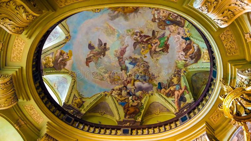Wonderful picturesque ceiling of the Baroque St. Nicholas Church on Lesser Town in Prague stock images