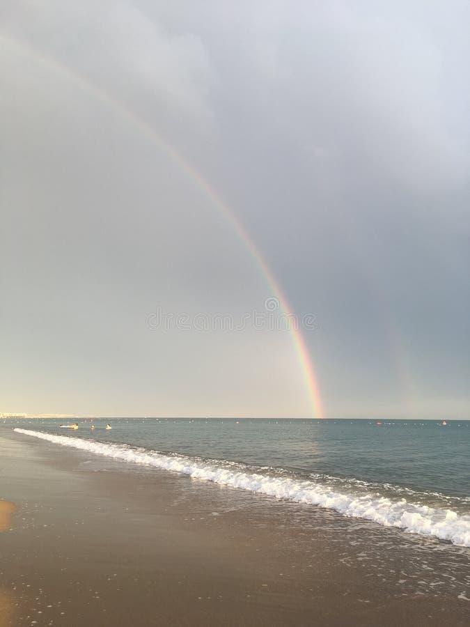 Wonderful rainbow over the sea and the beach in Turkey after heavy rain stock photo