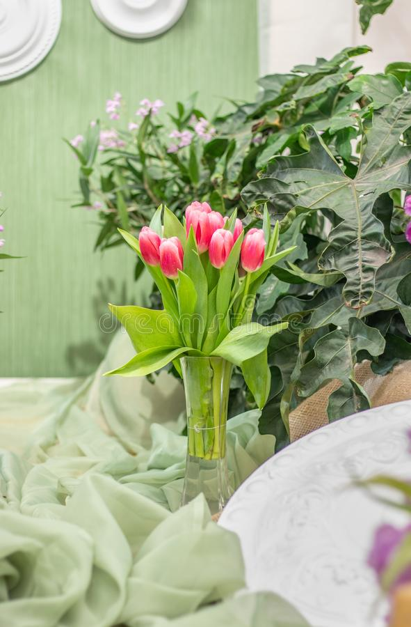 Wonderful red tulips in a vase stock photo