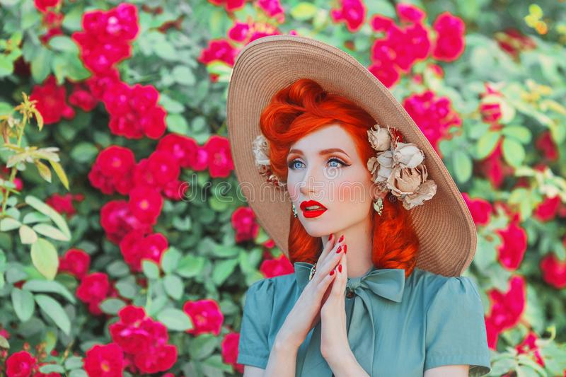 Wonderful retro girl in mint dress on beautiful summer background. Stylish woman. Fashionable summer clothes. Young luxury redhead stock photo