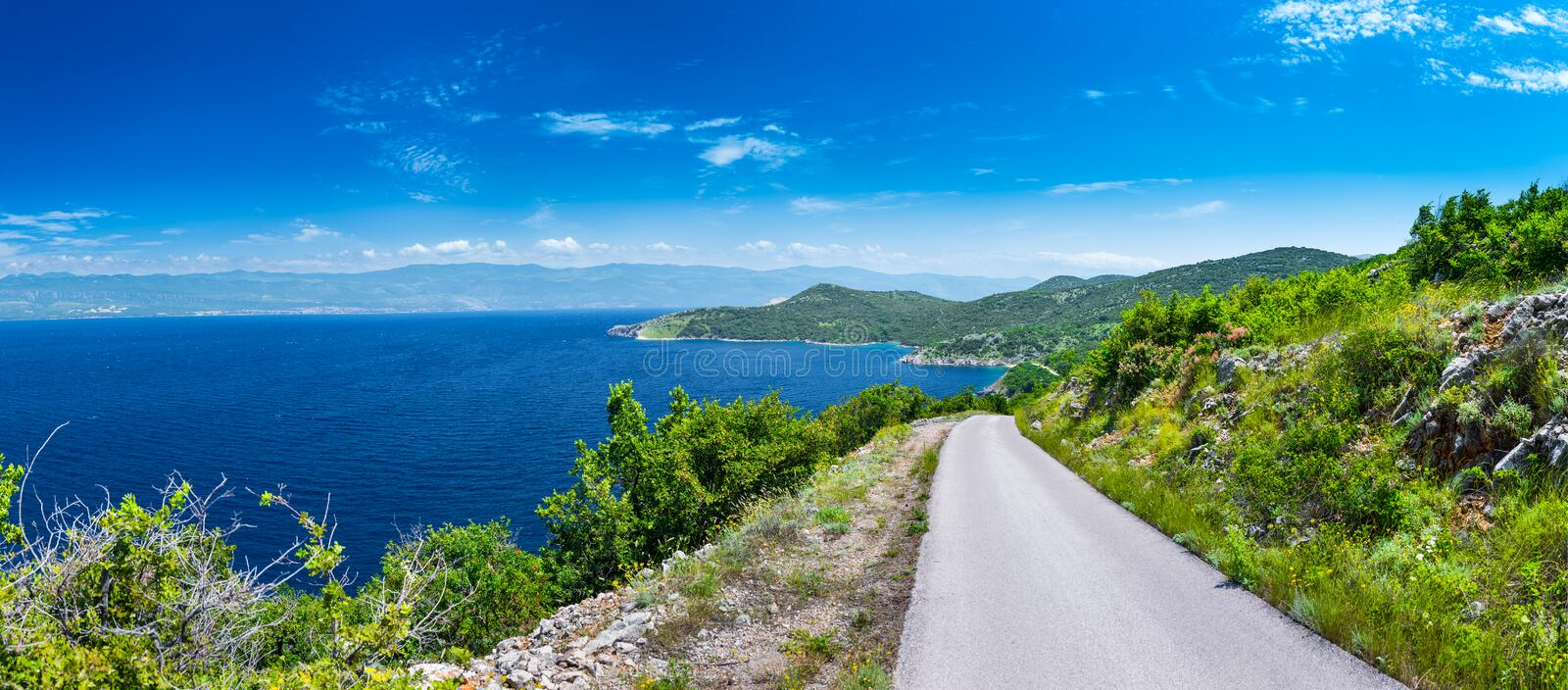 Wonderful romantic summer afternoon landscape panorama coastline Adriatic sea. A narrow mountain road above the cliffs along the c stock photo