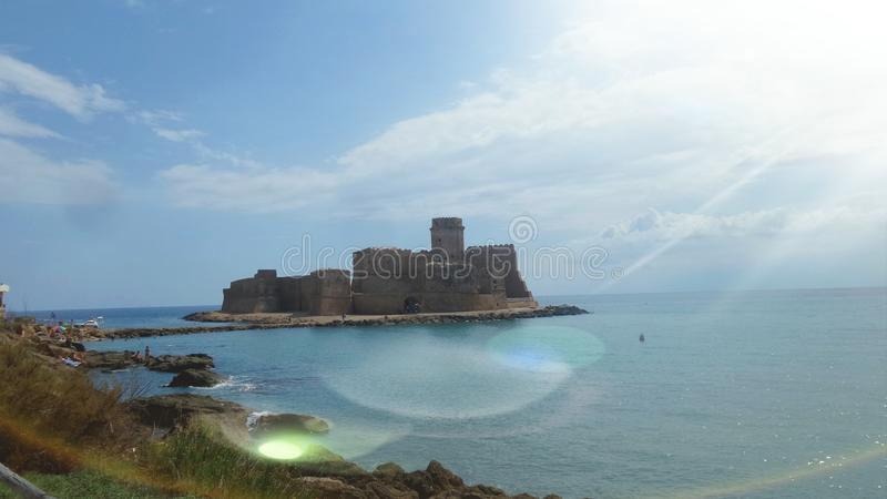 Le Castella is a fraction of Isola di Capo Rizzuto in the province of Crotone, in Calabria. The famous fortification, of probable stock photography