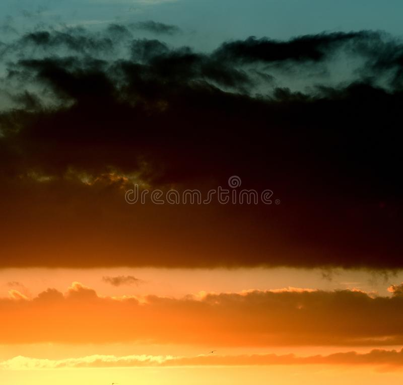 Wonderful sky. Vintage image of sunset sky with dark dramatic clouds. Background. Photograph, light. stock photography