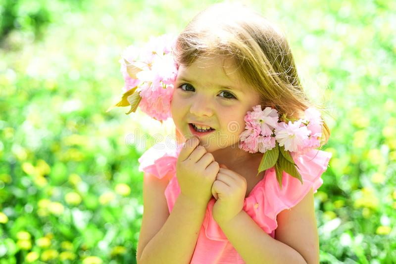Wonderful smell. Small child. Natural beauty. Childrens day. Springtime. weather forecast. Little girl in sunny spring. Wonderful smell. Small child. Natural stock photography