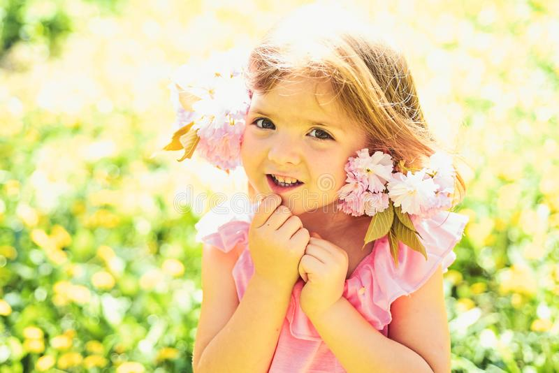Wonderful smell. Small child. Natural beauty. Childrens day. Springtime. weather forecast. Little girl in sunny spring. Summer girl fashion. Happy childhood royalty free stock photo
