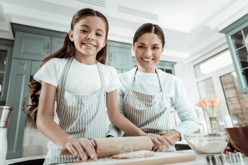 Good-looking lady spending a day with a daughter stock photo
