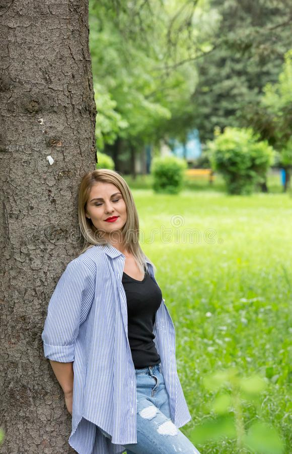A wonderful summer day with a beautiful girl. In a park in Transylvania stock photo