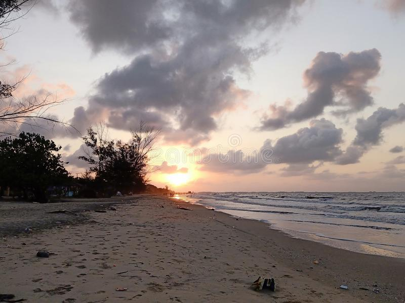 Wonderful, Sunrise on the sea at Angsana Beach royalty free stock image