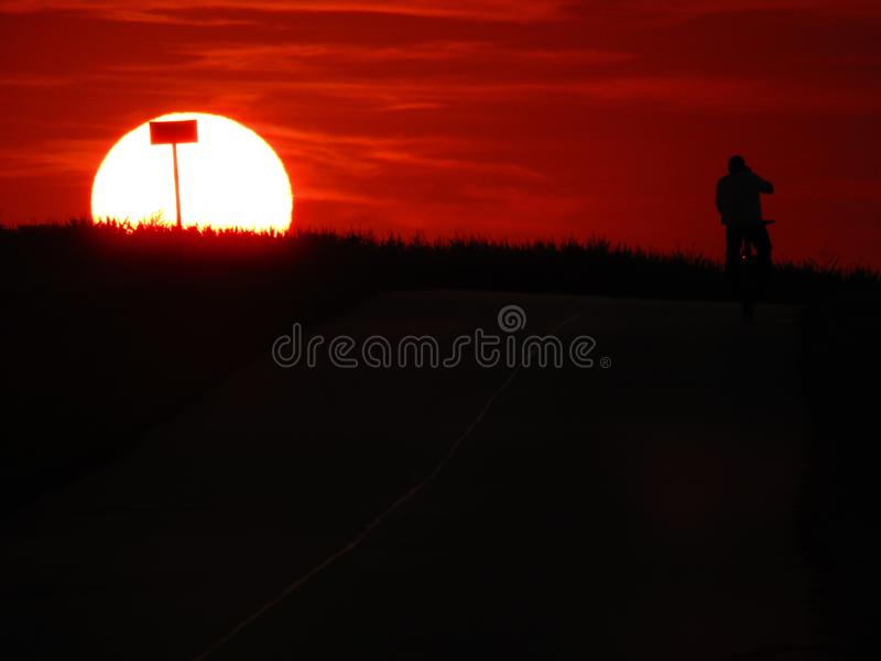 Wonderful sunset with a biker in Chelm Poland stock photo