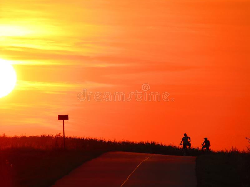 Wonderful sunset with 2 bikers in Chelm Poland royalty free stock image