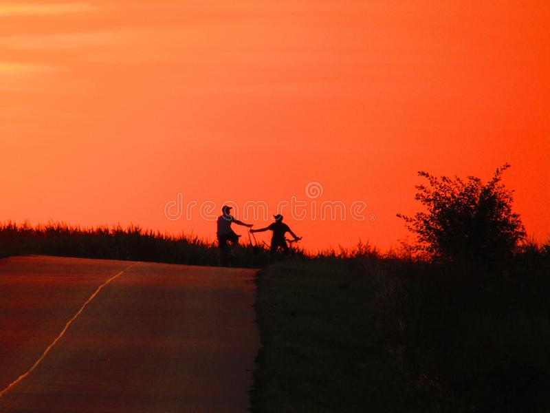Wonderful sunset with 2 bikers in Chelm Poland royalty free stock photography