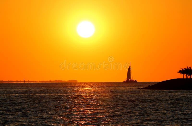 Wonderful sunset - sailing ship and an unbelieveable yellow and orange sky - Key West - Florida - USA royalty free stock photo