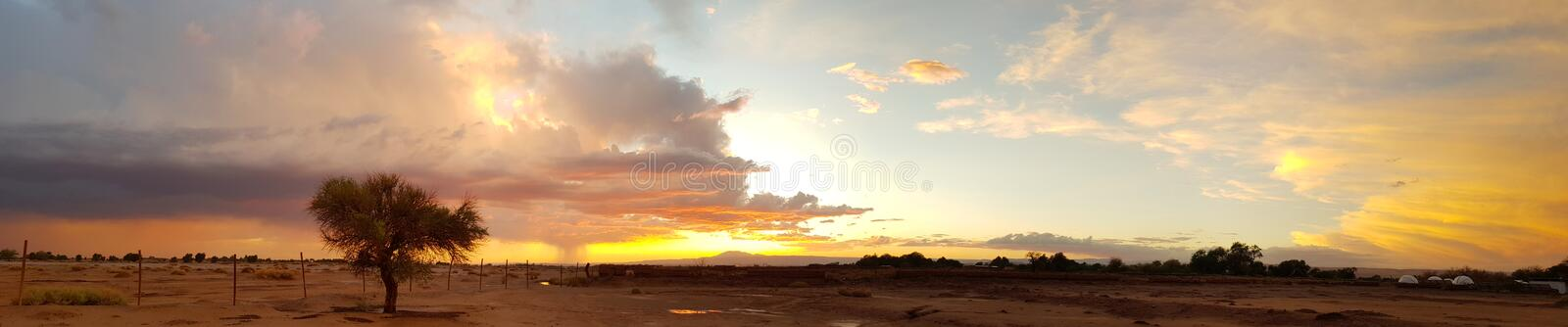 Wonderful sunset with thunderstorm in the arid and desolate landscape of the Atacama Desert. Sunset lights with thunderstorm in the arid and desolate landscape royalty free stock photos