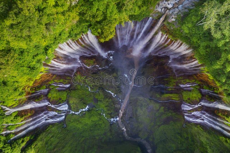 Wonderful Tumpak Sewu waterfall at Lumajang. Aerial view of wonderful Tumpak Sewu waterfall in the tropical forest at Lumajang, Indonesia royalty free stock images