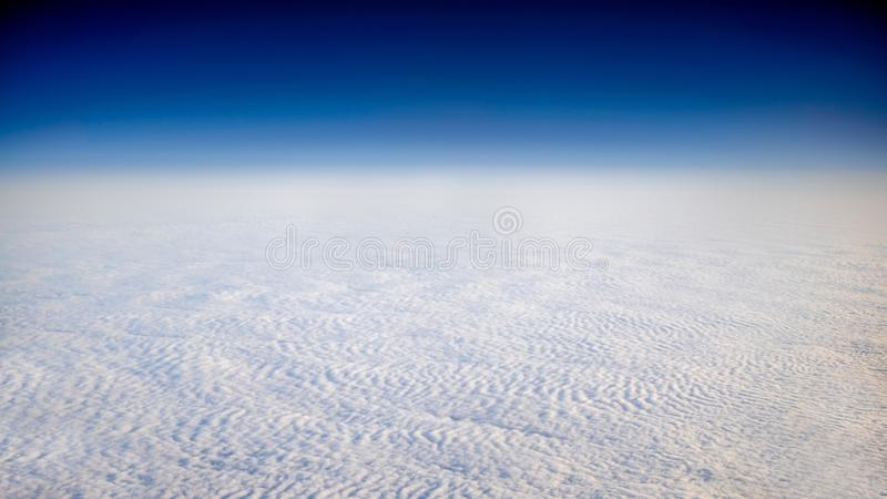 Wonderful view of cloudscape with clear blue sky from above stock photography