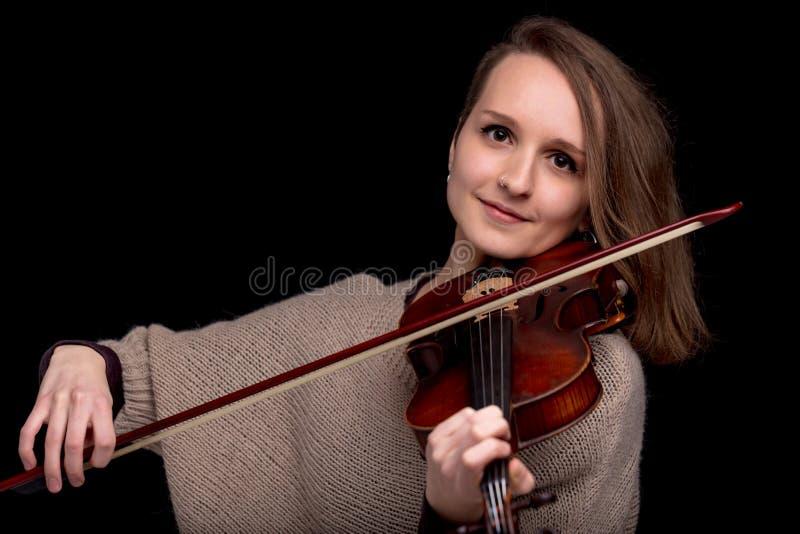 Wonderful violinist staring at camera stock photos