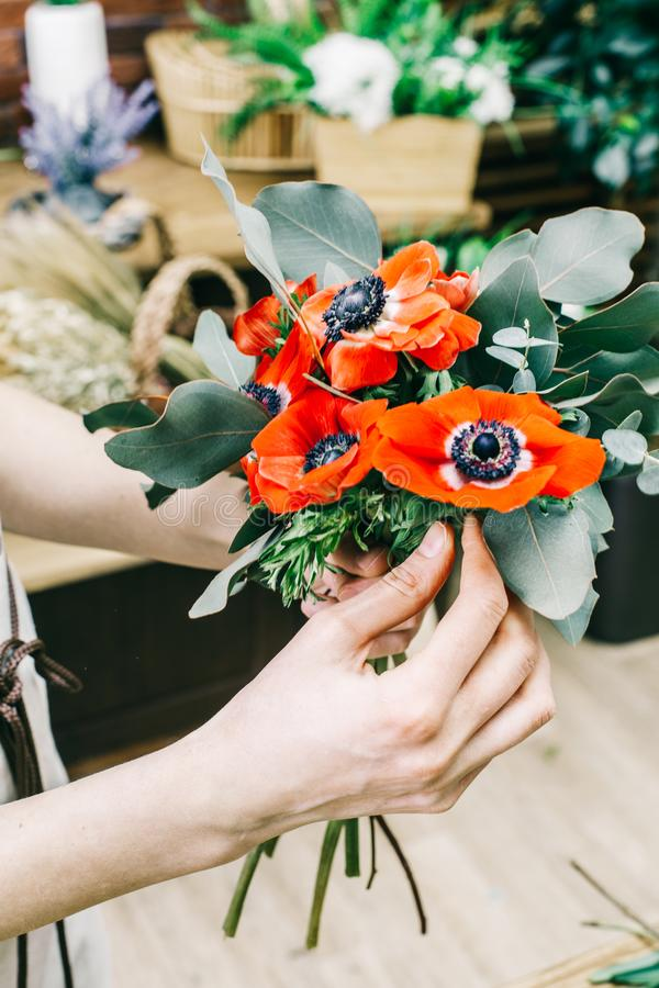 Wonderful vivid bouquet for sale stock image image of anonymous anonymous saleswoman showing vivid small bouquet with red poppy flowers and green foliage mightylinksfo