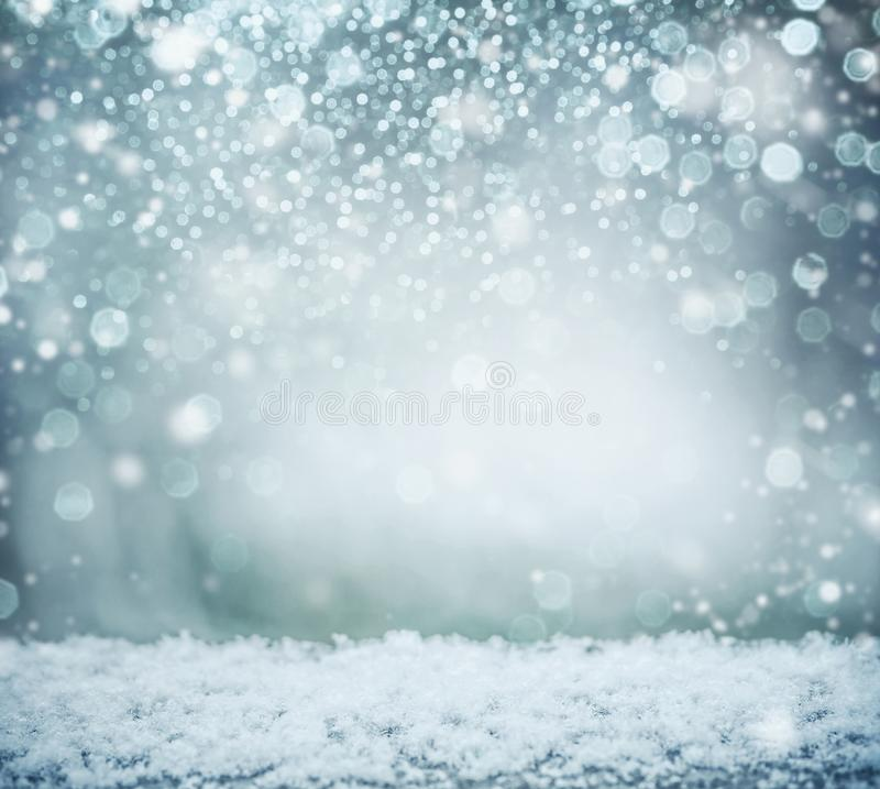 Wonderful winter background with snow and bokeh. Winter holidays stock photo