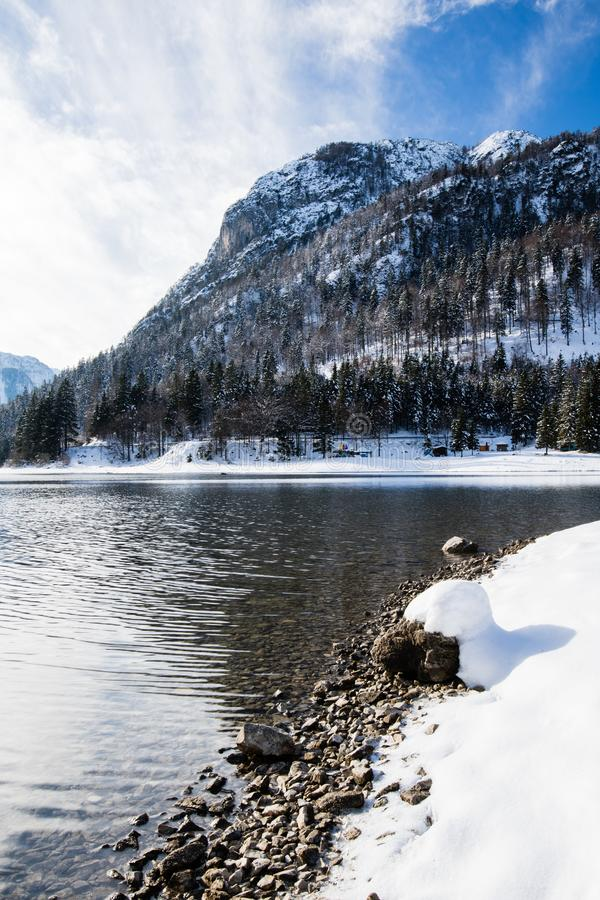 Wonderful winter scenery on mountain pass lake lago del predil in snowfall and sunny weather, julian alps, italy. Wonderful winter scenery on mountain pass lake stock image