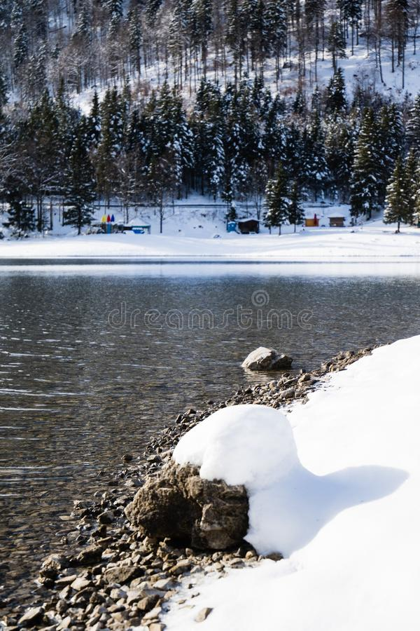 Wonderful winter scenery on mountain pass lake lago del predil in snowfall and sunny weather, julian alps, italy. Wonderful winter scenery on mountain pass lake stock images