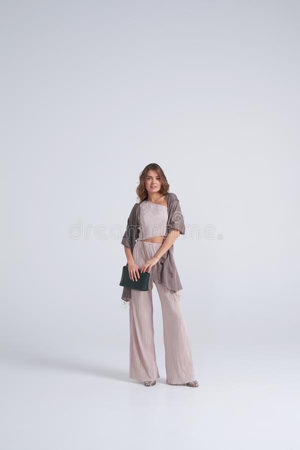 Wonderful woman posing in stylish clothes and accessories royalty free stock images