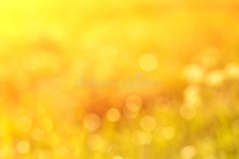 Wonderful yellow blurred background with sunlight. Bokeh.  stock image