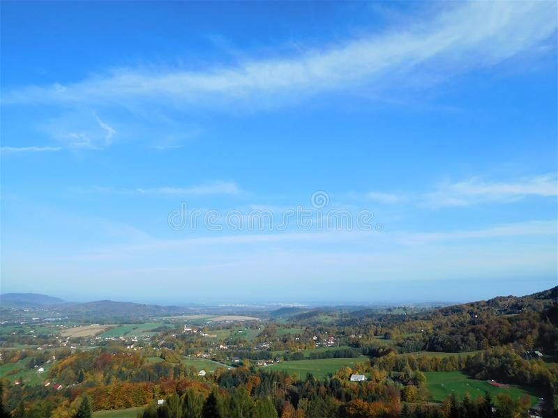 The wonderfull blue sky with small clouds stock image