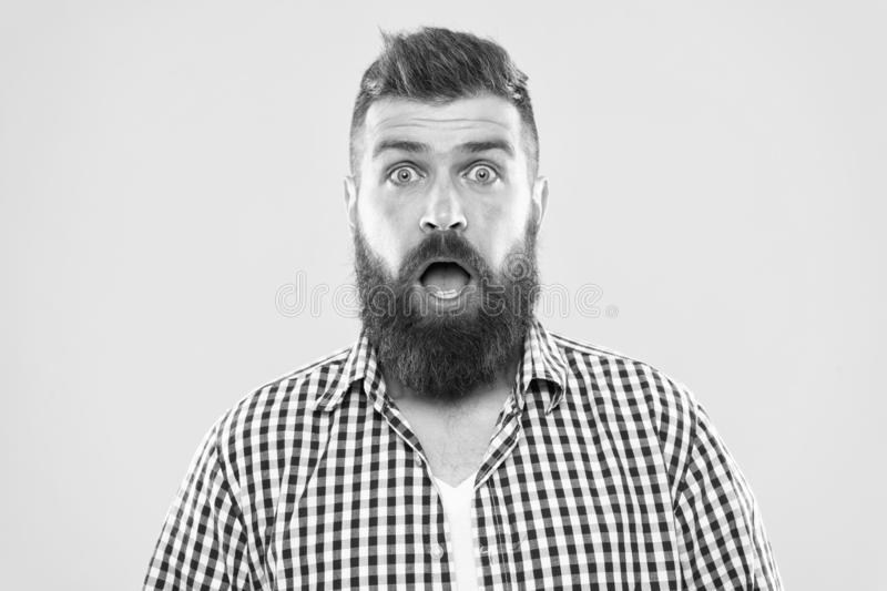 Wondering every time. Man bearded hipster wondering face yellow background close up. Guy surprised face expression stock image
