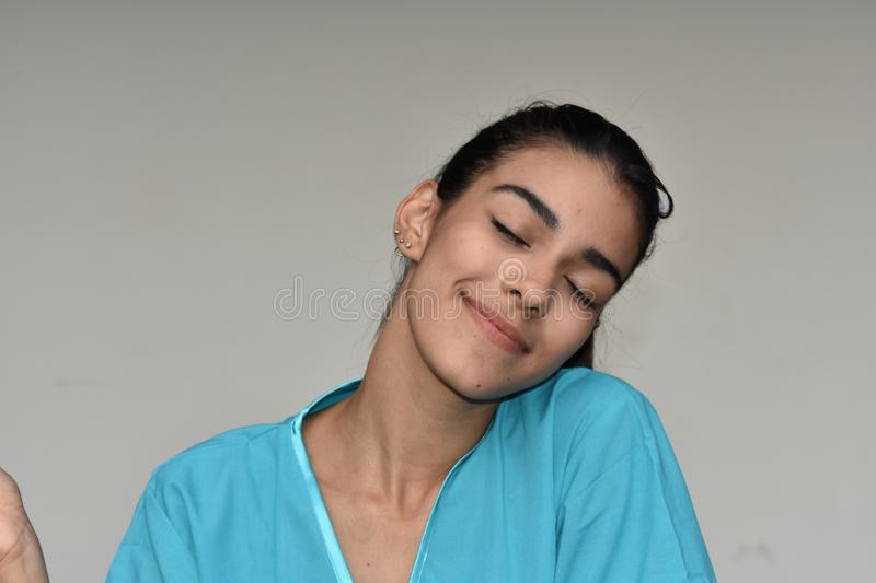Wondering Young Female Nurse. A young pretty Colombian teenage girl stock photos