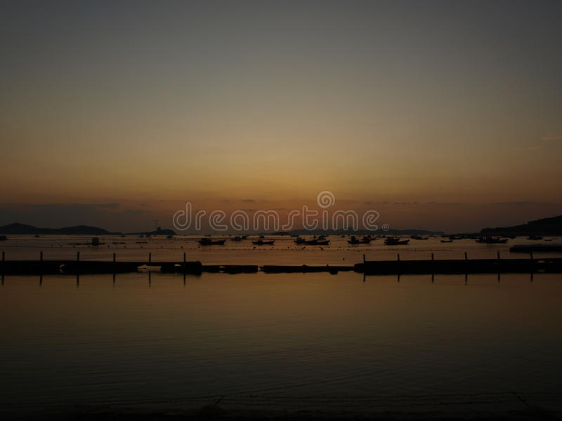 Wonderland. Fishing boat in the dusk at Chang DAO(paraphrase:Long island) in China royalty free stock images