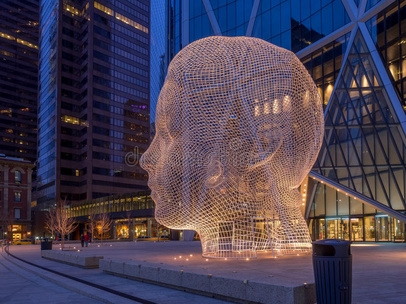 Wonderland sculpture, Calgary. CALGARY, CANADA - MAR 13: Wonderland sculpture by Jaume Plensa in the front of the Bow Tower on March 13, 2016 in Calgary, Alberta