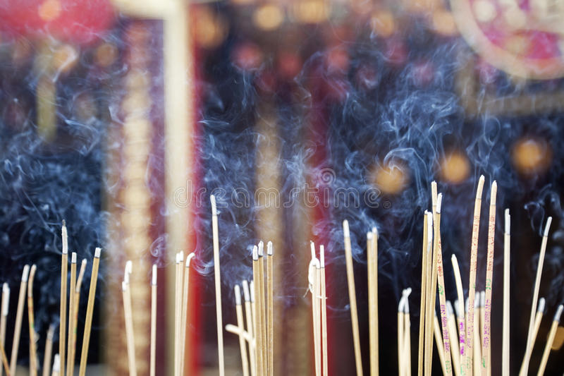 Wong Tai Sin Temple. Incense left burning by worshipers at Wong Tai Sin Temple. Also known as Sik Sik Yuen Wong Tai Sin Temple, is a Taoist Temple is located in royalty free stock photography
