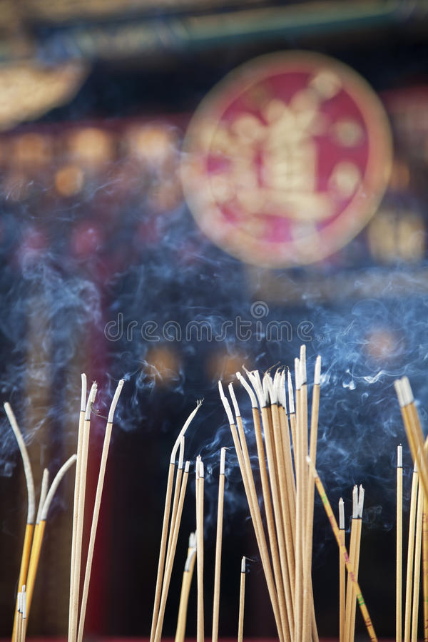 Wong Tai Sin Temple. Incense left burning by worshipers at Wong Tai Sin Temple. Also known as Sik Sik Yuen Wong Tai Sin Temple, is a Taoist Temple is located in stock photography