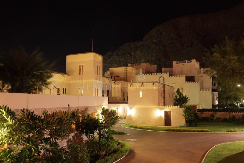 Woningbouw bij nacht, Oman stock foto