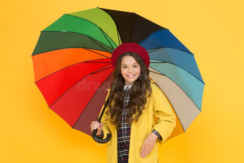 She wont get wet on September 1. Cute schoolgirl in autumn style hold umbrella on September 1. Small child back to. School on September 1. Little girl at first stock photos