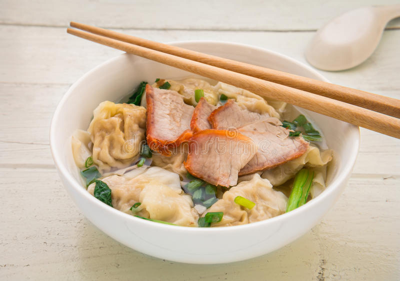 Wonton soup with roasted red pork, Chinese food stock photo