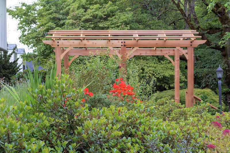 Wood Arbor in house Garden Landscaping. Wood Arbor in home garden backyard lush landscaping stock images