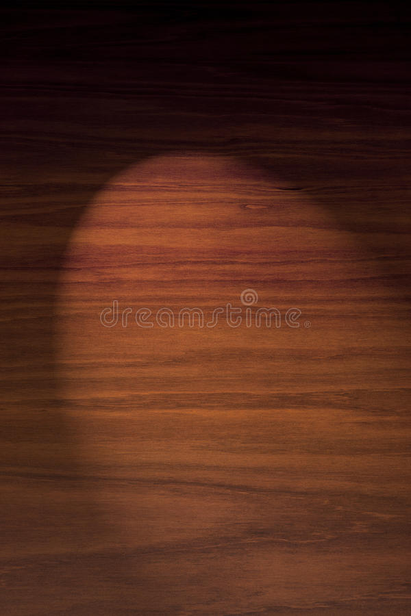 Wood Background With Spotlight. A rich dark wood background with a spot of light