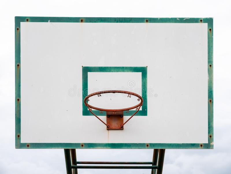 Wood basketball backboard with hoop green frame royalty free stock images