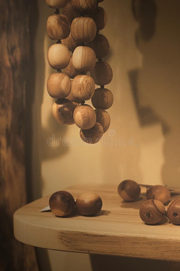 Wood beads - wood tears on the table stock photo