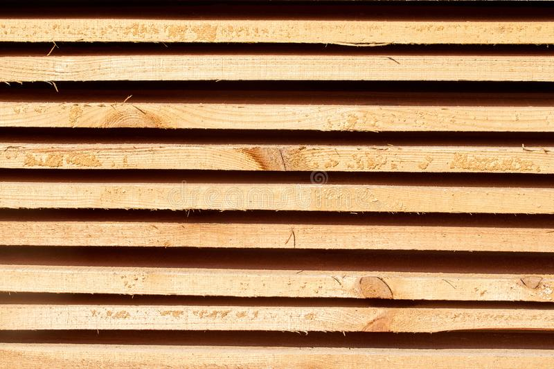 Wood beams background with a clear tree structure. Wooden beams background with a clear wood structure environmental friendliness convenience durability royalty free stock photo